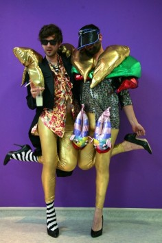 Assume Vivid Astro Focus two men heels gold pants